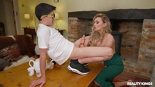 Sophisticated blonde MILF Amber Jayne enlightens a younger man