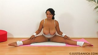 Provocative mature Danica Collins works out and masturbates
