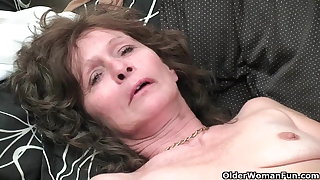 Granny with saggy tits and hairy pussy masturbates