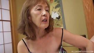 Asian milf Asano Taeko masturbates using her dildo and a dirty mind