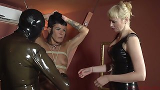 Perverted mistress Lorena Lee and one kinky chick punish cock of submissive dude in latex
