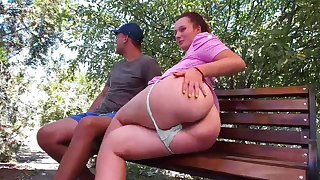 Horny girl in public park grabs stranger's cock on bench